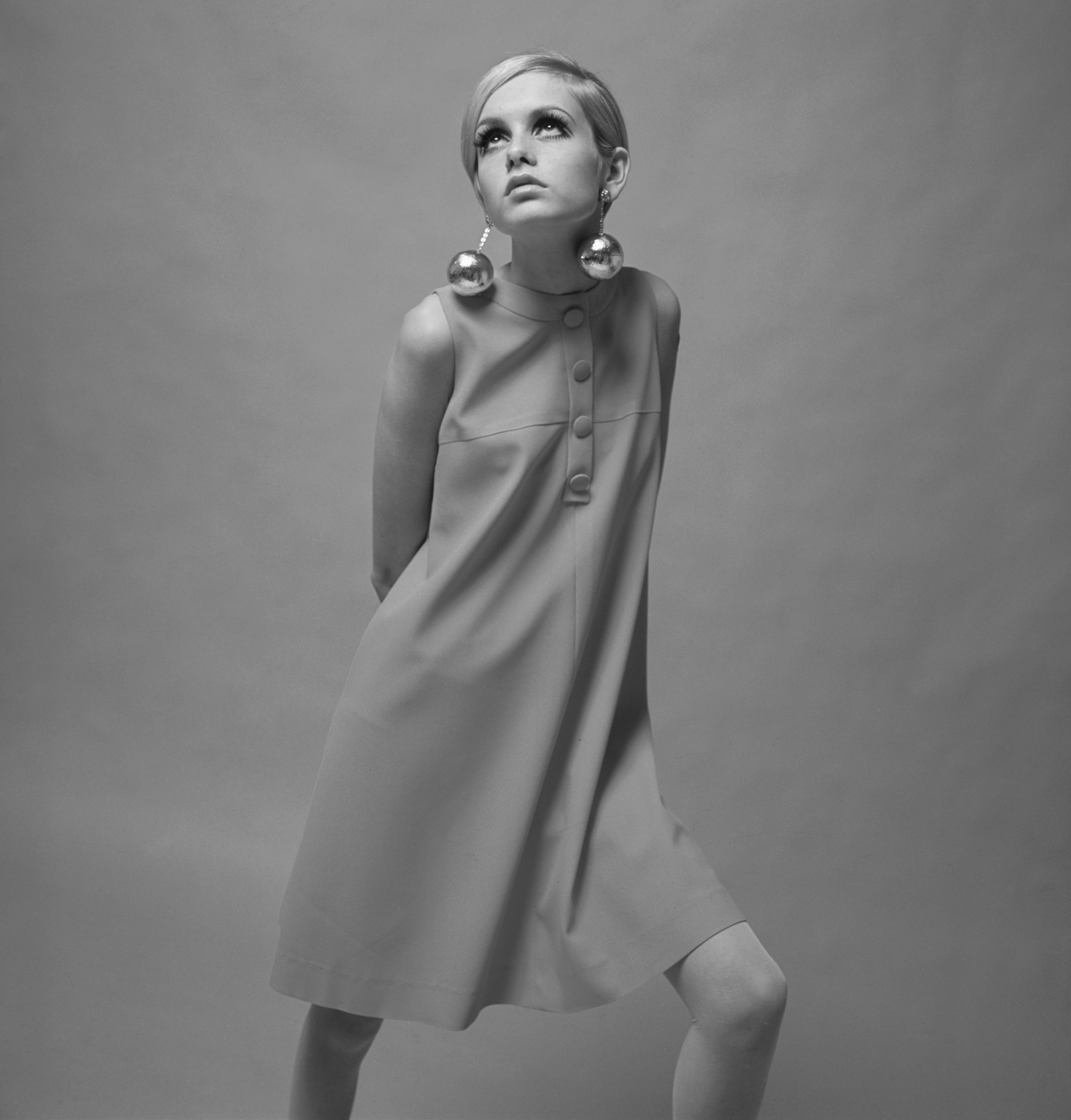 3rd December 1966, British Model Twiggy, (Lesley Hornby) is pictured wearing a pale pink mini dress  (Photo by Popperfoto/Getty Images)