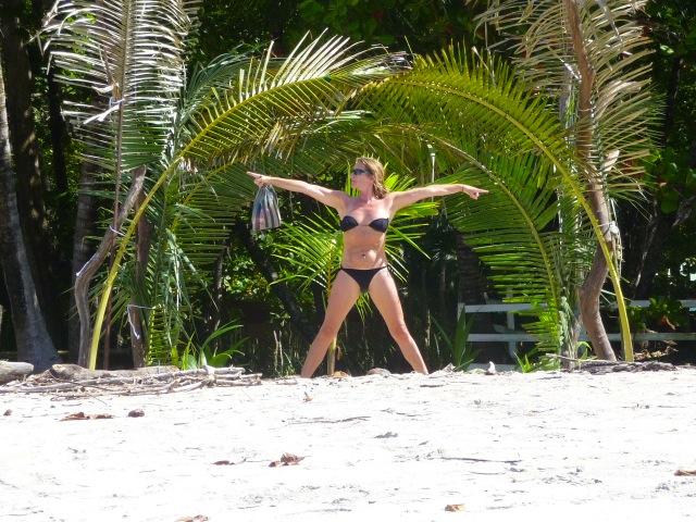Muscle woman on beach